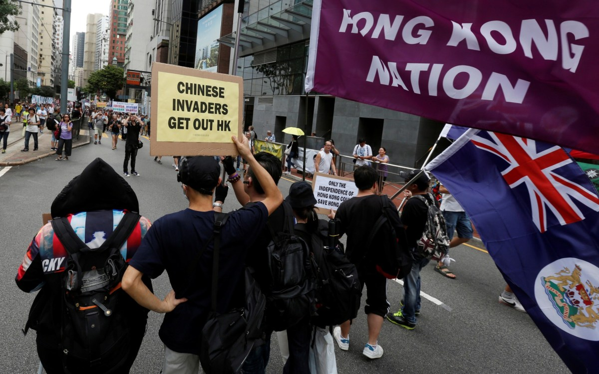Pro-independence protesters march on July 1, 2016, for the 19th anniversary of Hong Kong's return to Chinese sovereignty following a century and a half of British rule. Photo:   Reuters/Bobby Yip