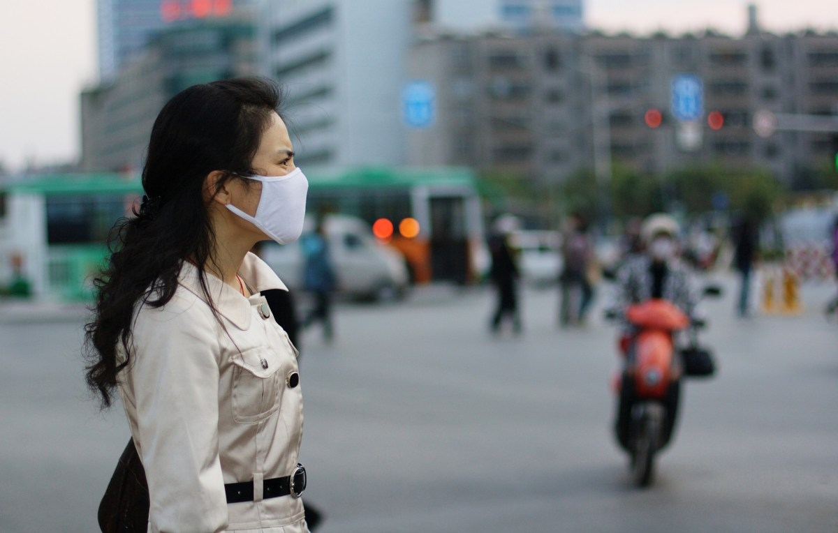 A woman in China protects herself against air pollution. Photo: iStock /  Getty