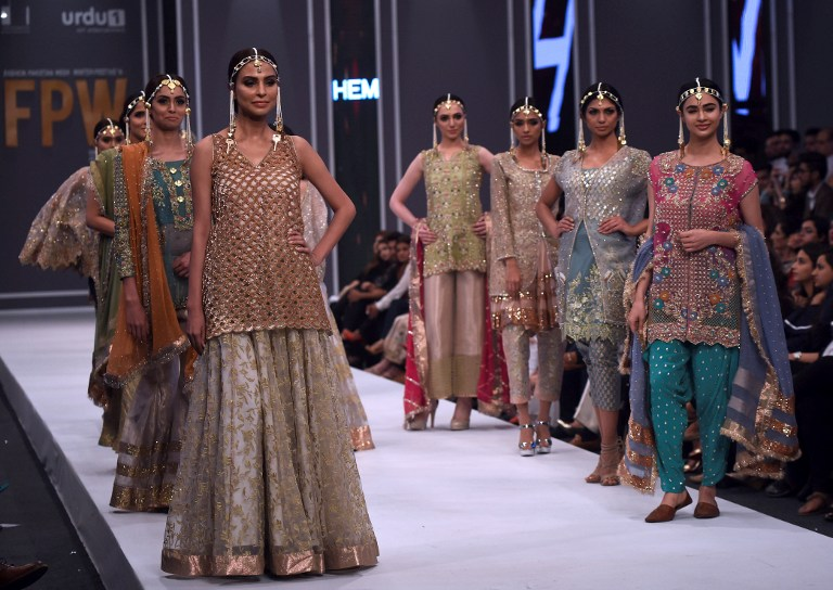 Models present creations by designer HEM at the Fashion Pakistan Week (FPW) Winter Festive 2016, in Karachi on October 31, 2016. Photo: Agence France-Presse