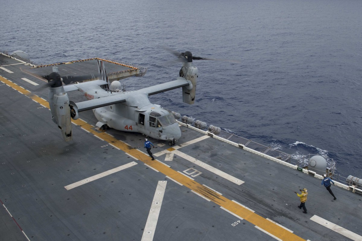 An Osprey aircraft lands on flight deck of the amphibious assault ship USS Bonhomme Richard operating in the South China Sea. Photo: Reuters