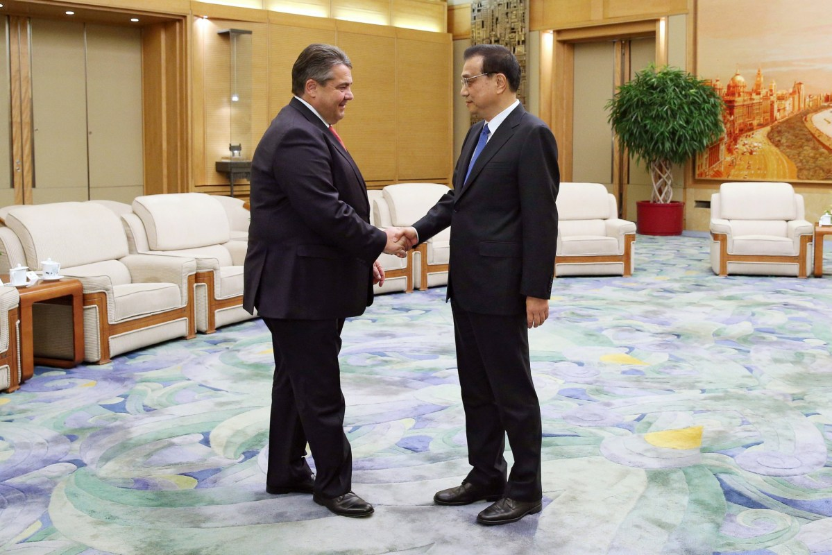 Sigmar Gabriel shakes hands with Chinese Premier Li Keqiang ahead of a meeting at the Great Hall on Tuesday. Photo: REUTERS/Wu Hong/Pool