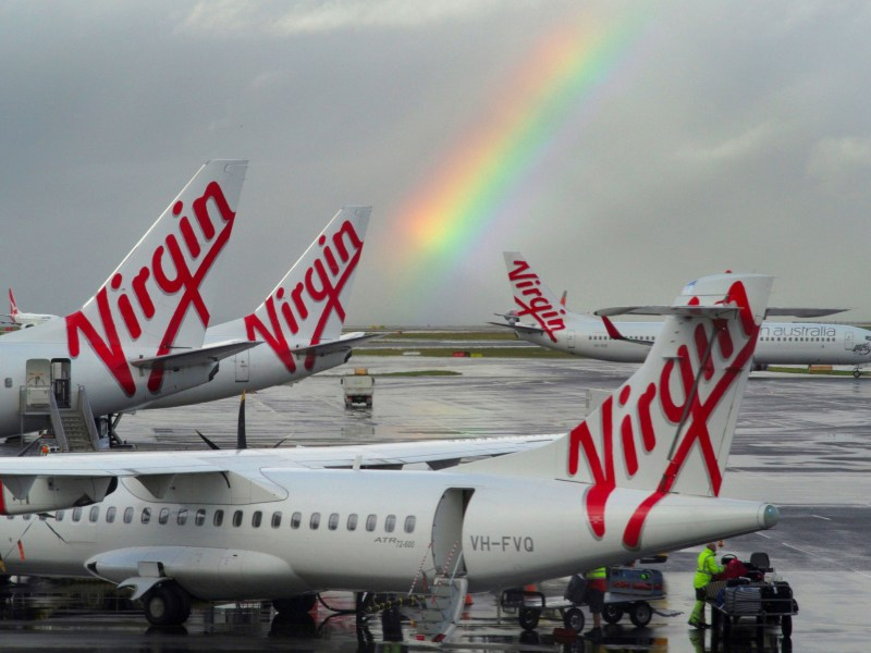 A rainbow from a passing rain shower sits over Virgin Australia aircraft at Sydney's Airport in Australia, August 5, 2016. Photo: Reuters/Jason Reed/File Photo