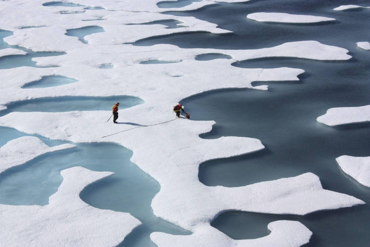 The crew of the US Coast Guard Cutter Healy, in the midst of their ICESCAPE mission, retrieves supplies in the Arctic Ocean in this July 12, 2011. Photo: Kathryn Hansen/NASA via Reuters