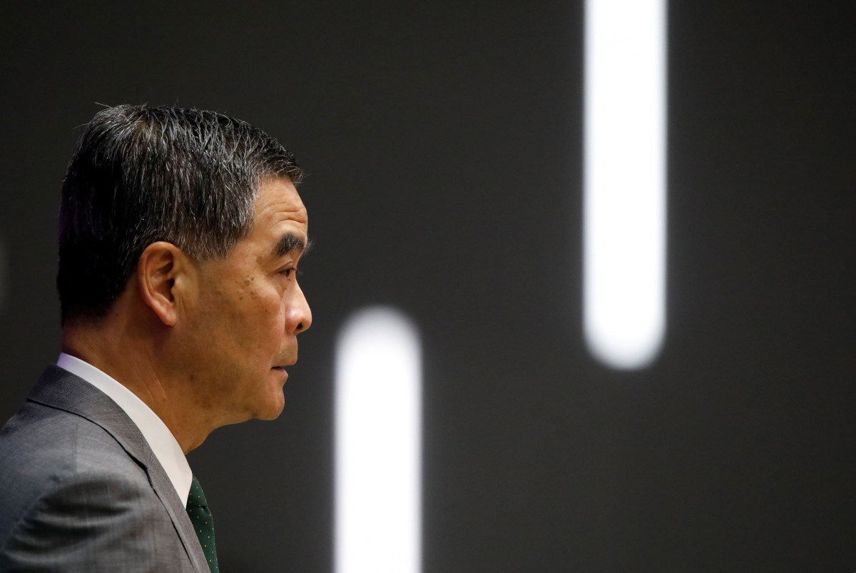Hong Kong Chief Executive Leung Chun-ying addresses a news conference after Beijing passed an interpretation of Hong Kong's Basic Law that says lawmakers must swear allegiance to the city as part of China. Photo: Reuters/Tyrone Siu