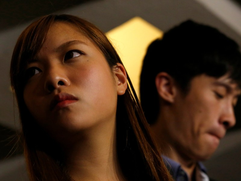 Pro-independence activists Yau Wai-ching (L) and Baggio Leung meets journalists outside the High Court after the court disqualified them from taking office as lawmakers in Hong Kong, China November 15, 2016. Photo: Reuters/Bobby Yip