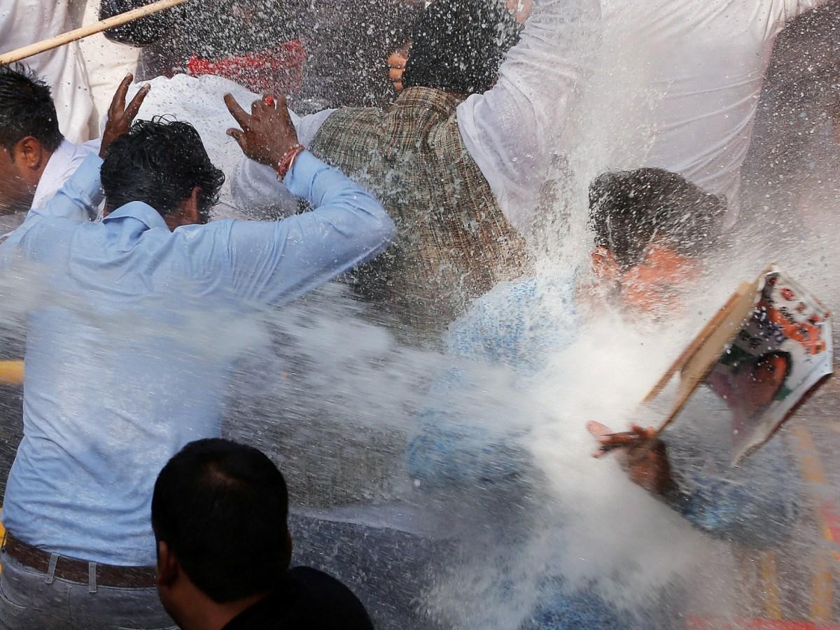 Hosing the zone... Photo: Reuters/Adnan Abidi