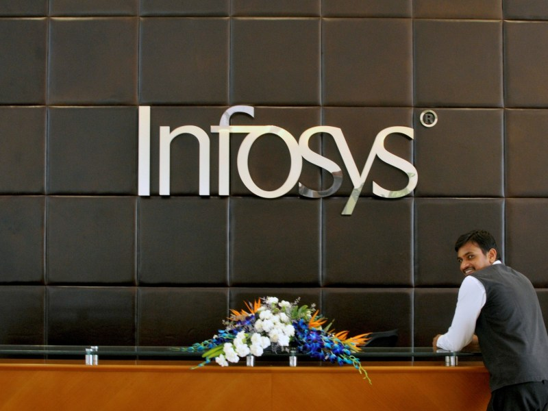 An employee of Infosys stands at the front desk of its headquarters in Bengaluru, India, April 15, 2016. Photo: Reuters/Abhishek N. Chinnappa