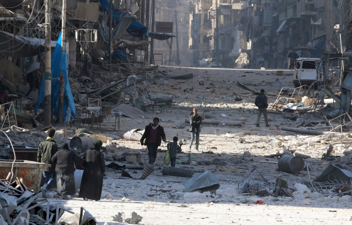 Syrians carry their belongings through streets of rubble as they flee clashes between government forces and rebels in Tariq al-Bab and al-Sakhour neighborhoods of eastern Aleppo towards other rebel-held besieged areas. Photo: Reuters/Abdalrhman Ismail