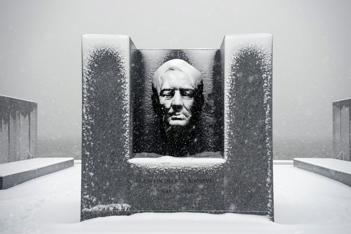 Snow falls on the statue of Franklin D. Roosevelt at Four Freedoms Park on Roosevelt Island.