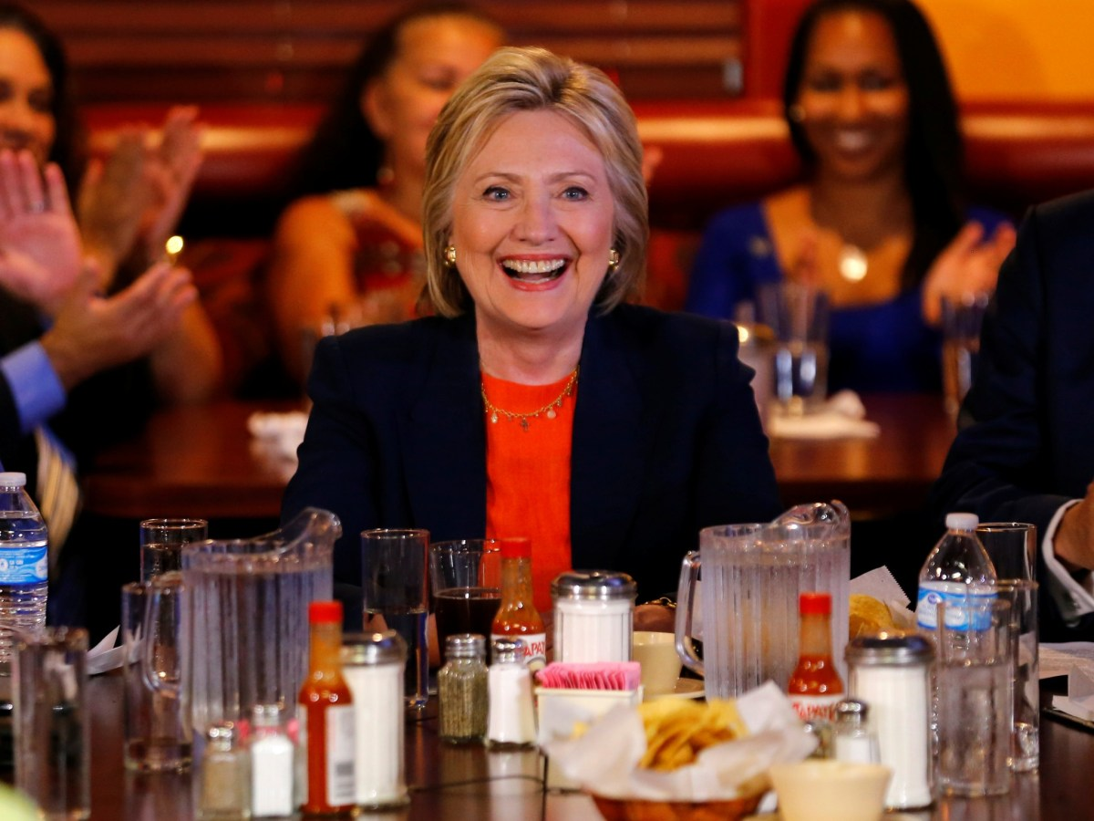 U.S. Democratic presidential candidate Hillary Clinton makes a campaign stop at a restaurant in Perris, California. Photo: REUTERS/Mike Blake