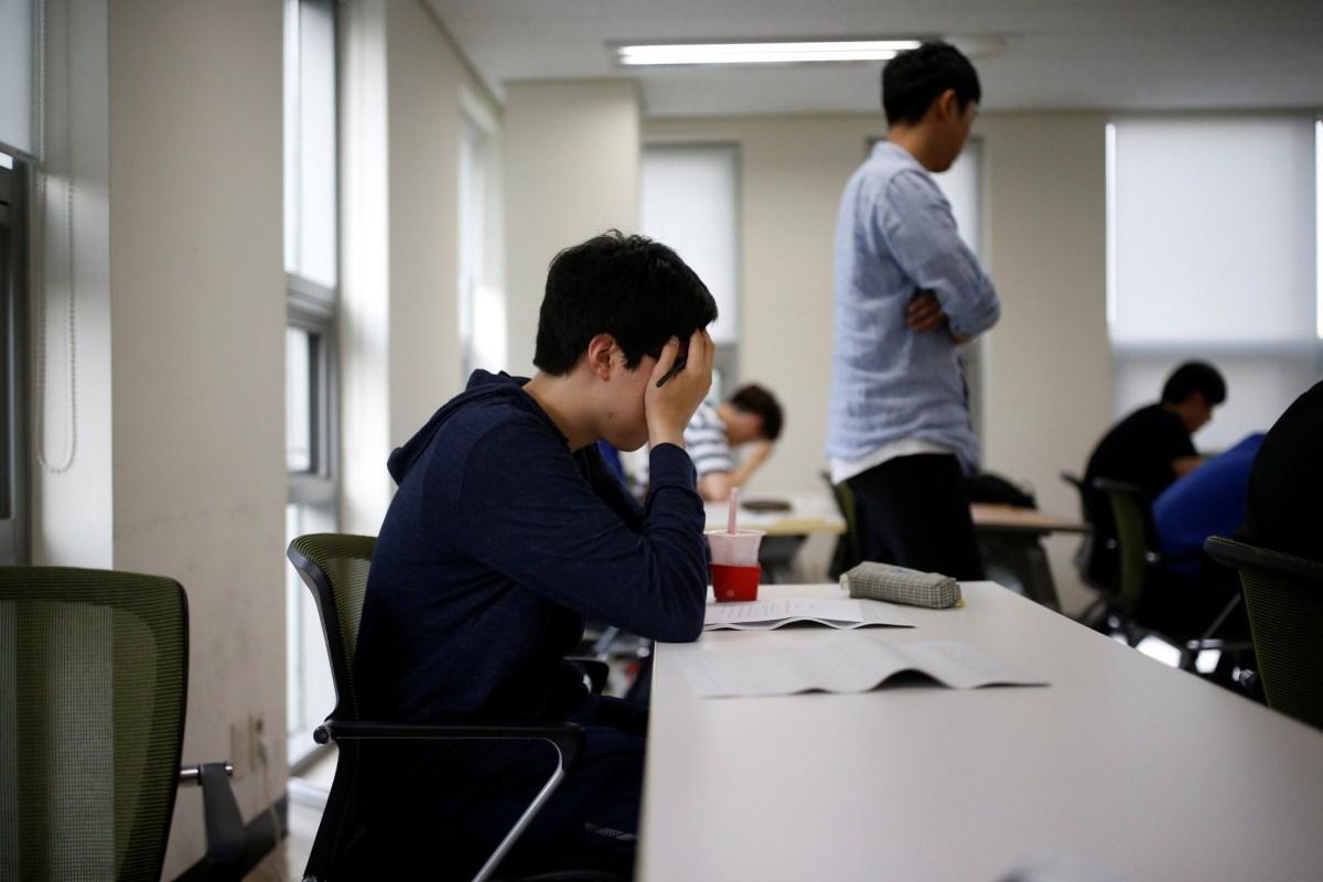 Students take part in an exam in Seoul, South Korea. Photo: REUTERS/Kim Hong-Ji