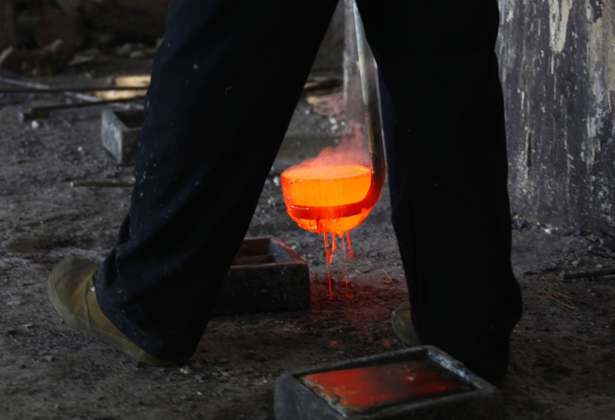A worker prepares to pour molten lanthanum, a rare-earth metal, into a mold at a smelter in China's Inner Mongolia Autonomous Region in 2010. Photo: Reuters / David Gray