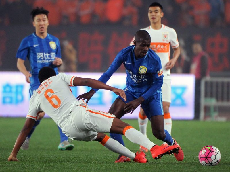 Jiangsu Suning's Ramires (second right) is said to earn US$14.5 million per year from the club. Photo: AFP