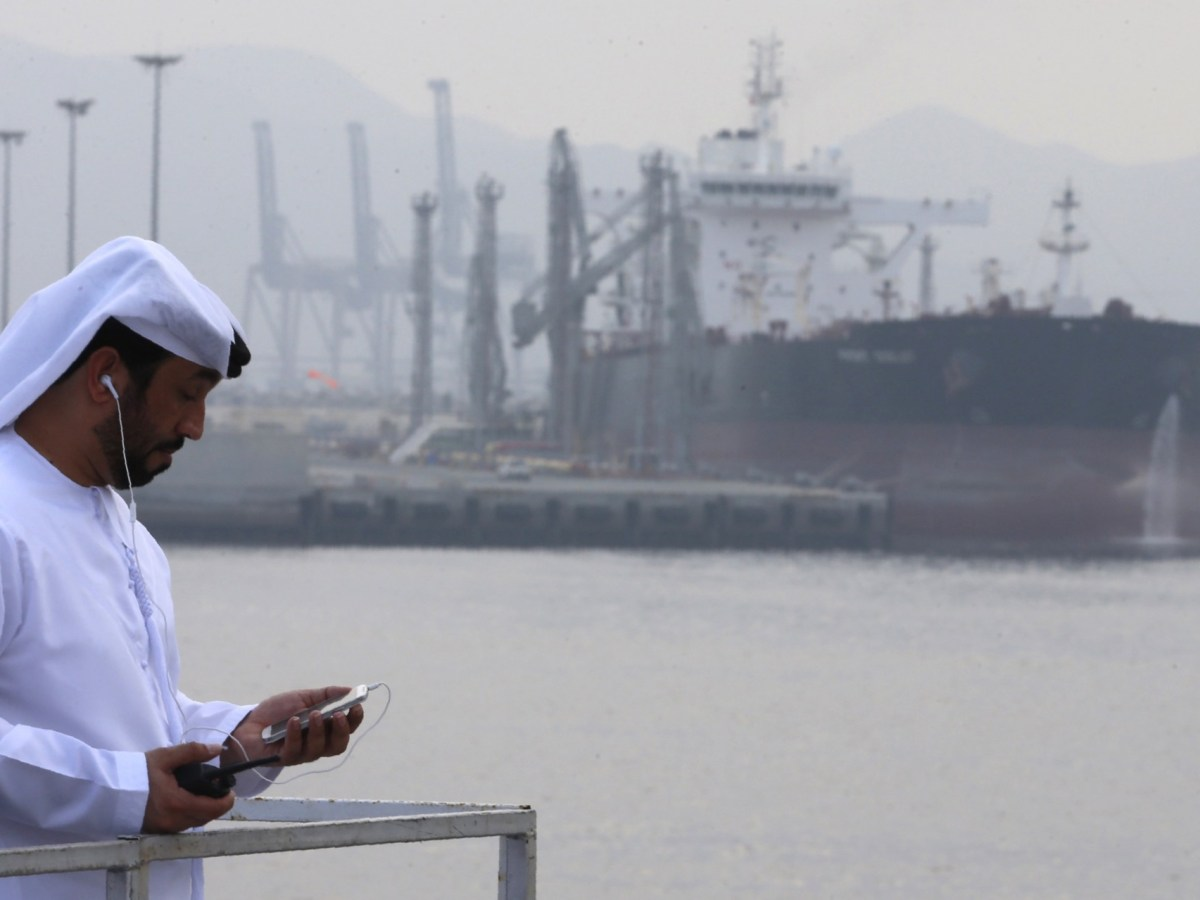 A man stands at an oil terminal at Fujairah, in the United Arab Emirates. Photo: Karim Sahib / AFP