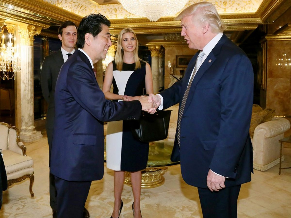 Japanese Prime Minister Shinzo Abe meets US President-elect Donald Trump in late 2016 as son-in-law Jared Kushner and daughter Ivanka look on. Photo: AFP