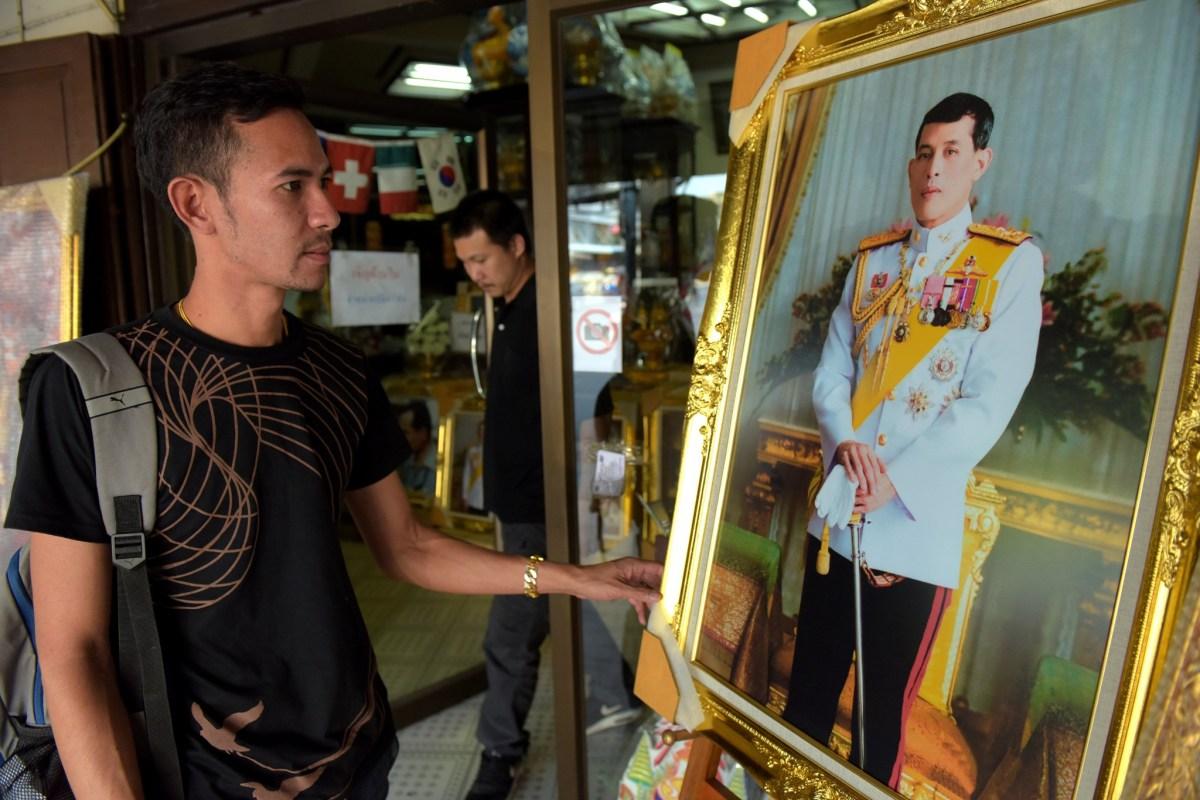 A portrait photo of Crown Prince Maha Vajiralongkorn on sale at a Bangkok shop on November 30, 2016. AFP/Tang Chhin Sothy