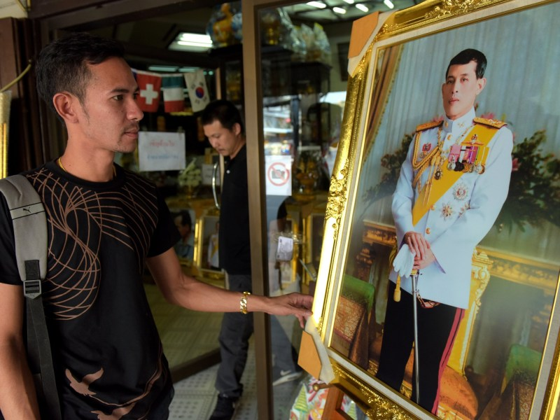 A portrait photo of Crown Prince Maha Vajiralongkorn on sale at a Bangkok shop on November 30, 2016. AFP/Tang Chhin Sothy