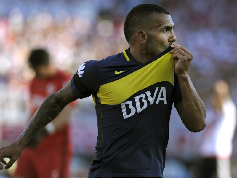 Boca Juniors' forward Carlos Tevez celebrating after scoring the team's second goal against River Plate during their Argentina First Division football match at El Monumental stadium in Buenos Aires. Argentina's former Manchester United and Manchester City striker Carlos Tevez has signed for Shanghai Shenhua in the latest big-money Chinese deal, the club said on December 29, 2016, reportedly making him the world's best-salaried footballer. Photo: Alejandro Pagni/ AFP