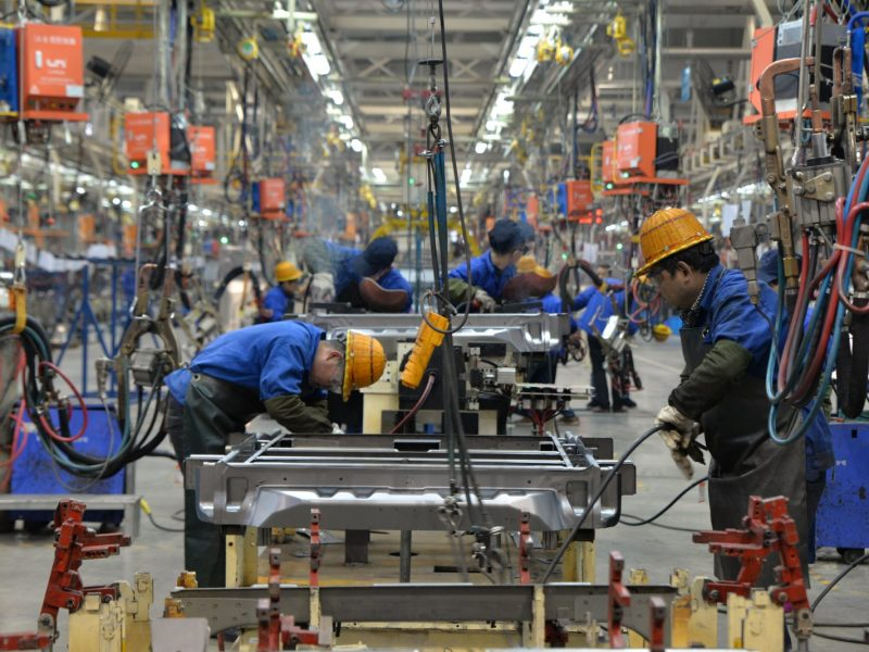 Workers assemble cars in an auto plant in Zunyi, a city in southwest China's Guizhou province. Photo: AFP