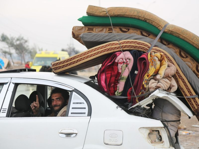 A convoy evacuating civilians and opposition group members from east Aleppo arrives in opposition controlled Rashideen Town on December 22, 2016. Photo: AFP/ Ahmed Al Ahmed