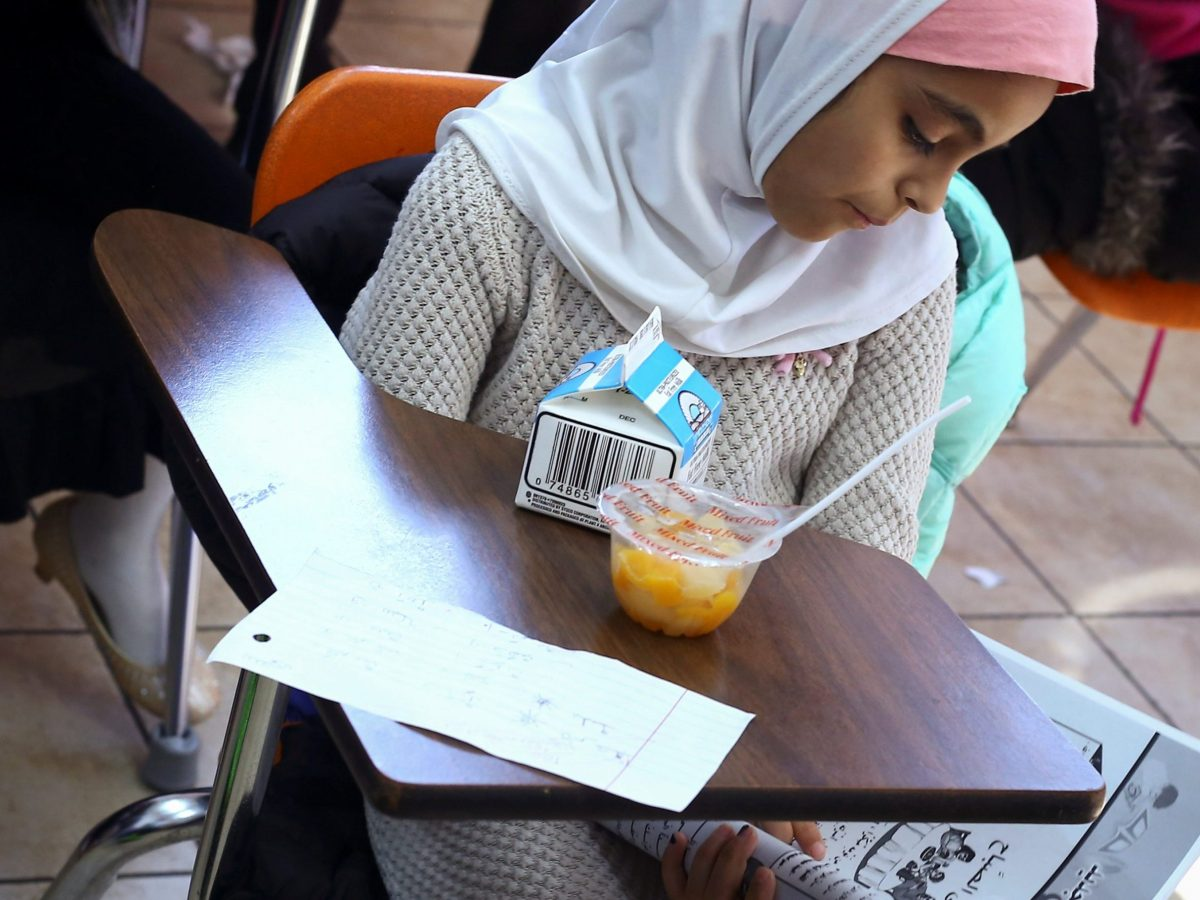 Saja Mashgar, 8, sports a hijab while reading a workbook during Arabic language class at Masjid Al-Salaam, a mosque and Islamic community center in Dearborn, Michigan, U.S., November 13, 2016.   REUTERS/Brittany Greeson