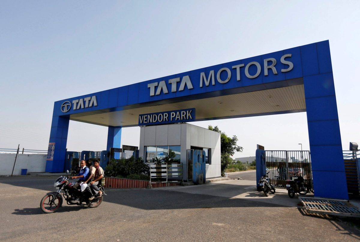 Men ride a motorbike as they come out of a past a Tata Motors car plant at Sanand in the western Indian state of Gujarat. Photo: Reuters/Amit Dave