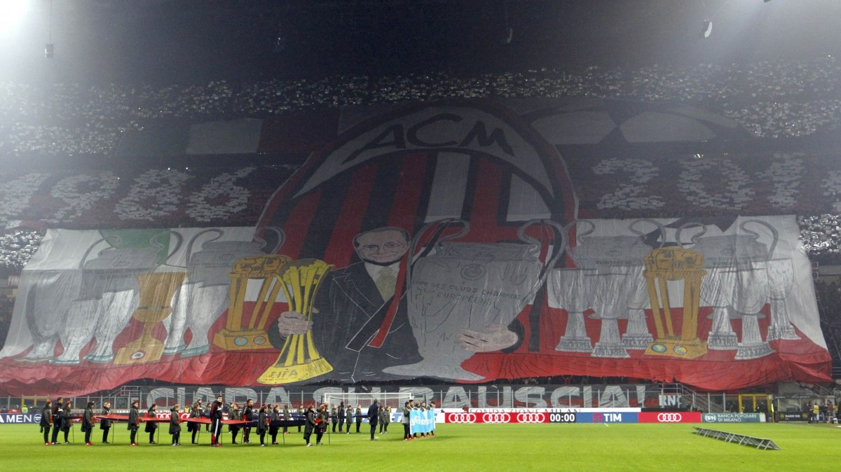 AC Milan supporters unfurl a huge banner before a game at the San Siro statium. Photo: Reuters/Alessandro Garofalo