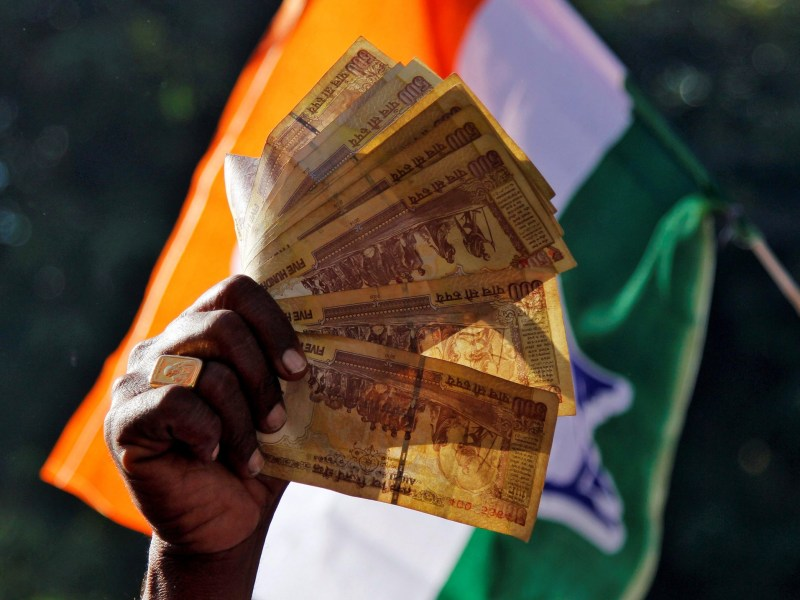 A man displays 500 Indian rupee notes during a rally organised by India's main opposition Congress party against the government's decision to withdraw 500 and 1000 Indian rupee banknotes from circulation, in Ajmer, India, in November. Photo: Reuters / Himanshu Sharma