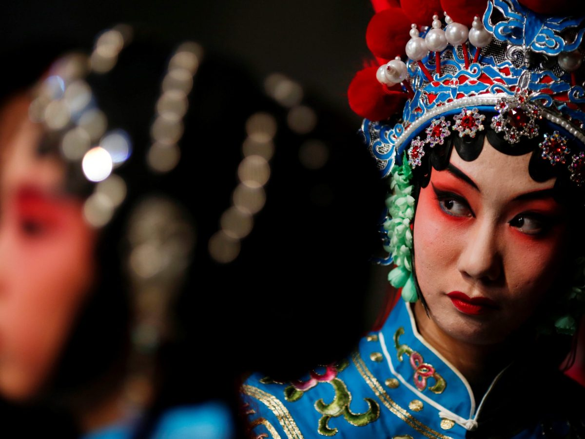 Participants wait for their turn backstage during a traditional Chinese opera competition at the National Academy of Chinese Theatre Arts in Beijing, China, November 26, 2016. REUTERS/Thomas Peter