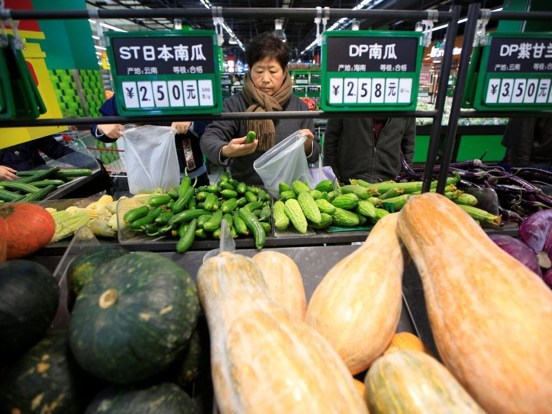 Consumers choose vegetables at a supermarket in Shanghai. Photo:   Reuters/Aly Song