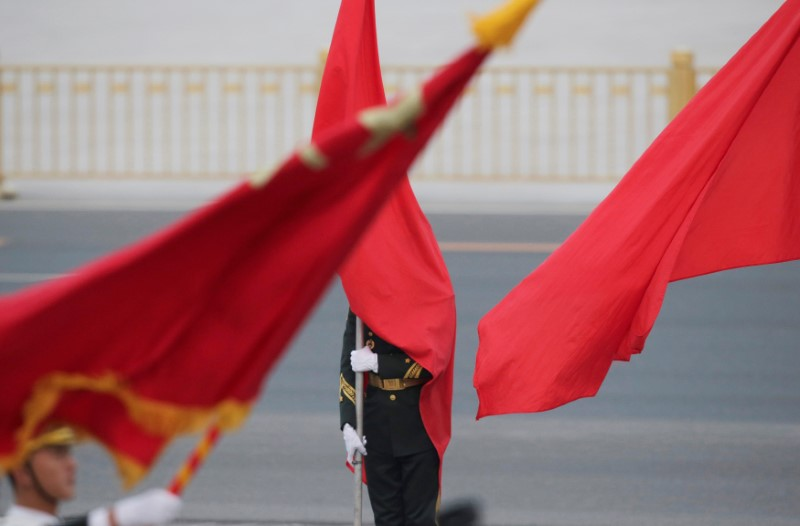 A red flag covers a soldier from the honour guards during a welcoming ceremony for Malaysia's Prime Minister Najib Razak outside the Great Hall of the People, in Beijing, China, November 1, 2016. Photo: Reuters/Jason Lee