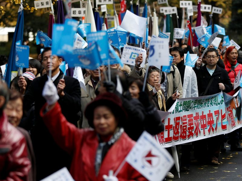 'Northern protesters' march in Tokyo to demand the return of disputed islands, the Southern Kuriles, from Russia in December 2016 ahead of a visit by Russian President Vladimir Putin. Photo: Reuters/ Issei Kato