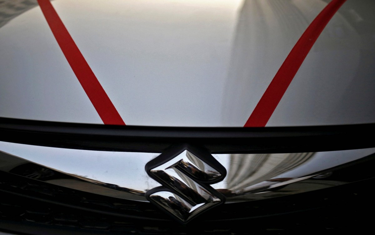 The logo of Maruti Suzuki India Ltd is seen on a car parked outside a showroom in New Delhi. Photo: Reuters