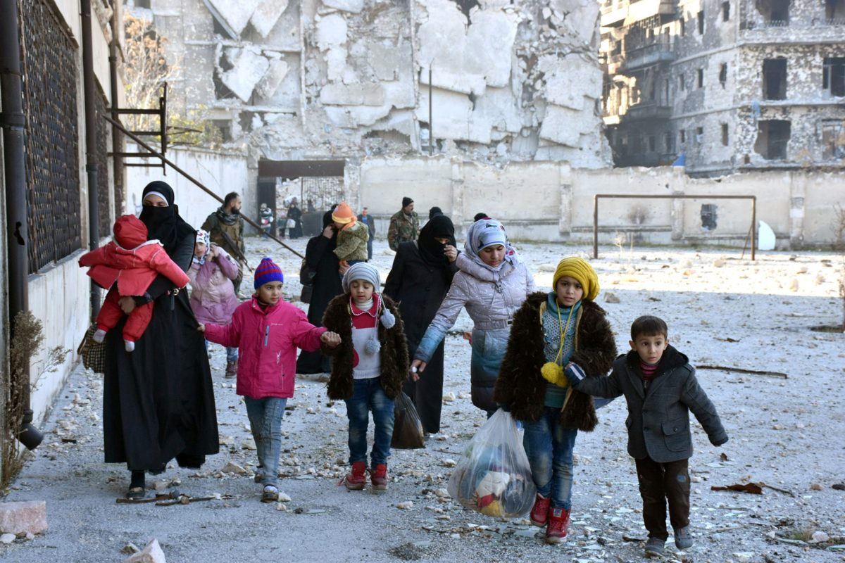 Civilians evacuate the eastern districts of Aleppo. Photo: Sana/Handout via Reuters