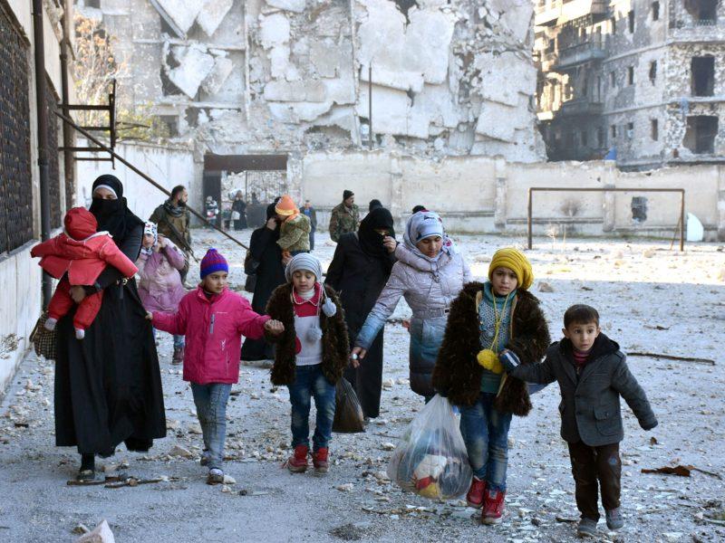 Civilians evacuate the eastern districts of Aleppo. Photo: Sana/Handout via Reuters