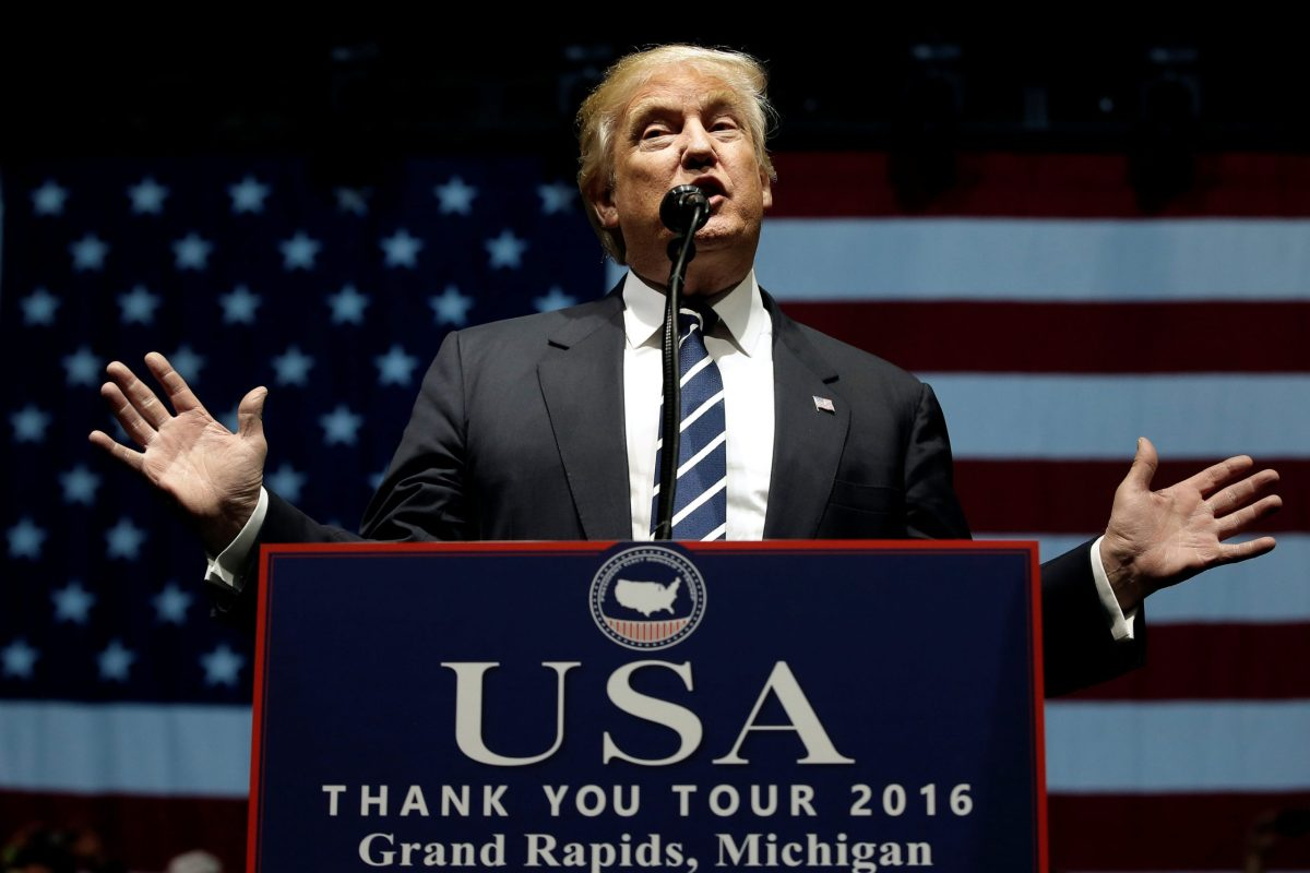 """US President-elect Donald Trump speaks at a """"Thank You USA"""" tour rally in Grand Rapids, Michigan. December 9, 2016.  Photo: Reuters/Mike Segar"""