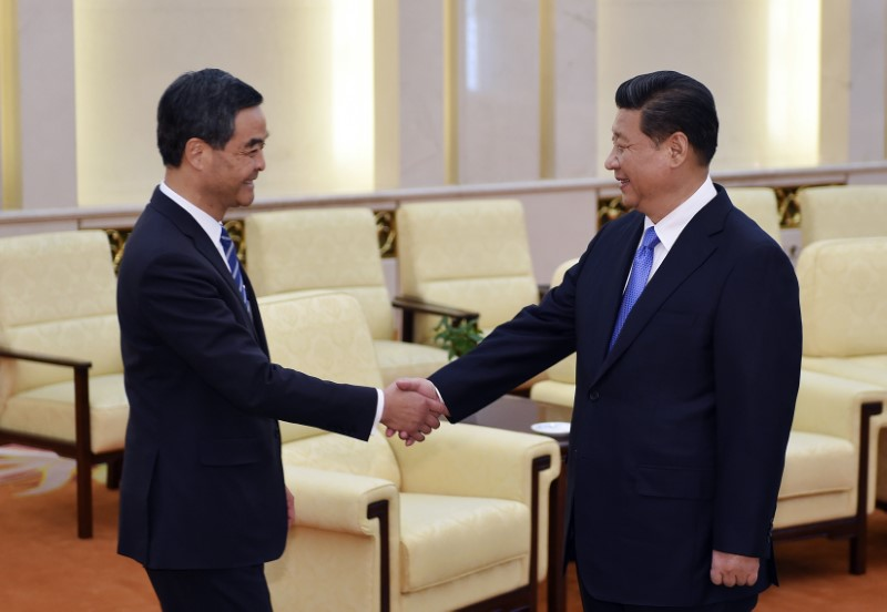 China's President Xi Jinping (R) shakes hands with Hong Kong Chief Executive Leung Chun-ying. Photo: Reuters