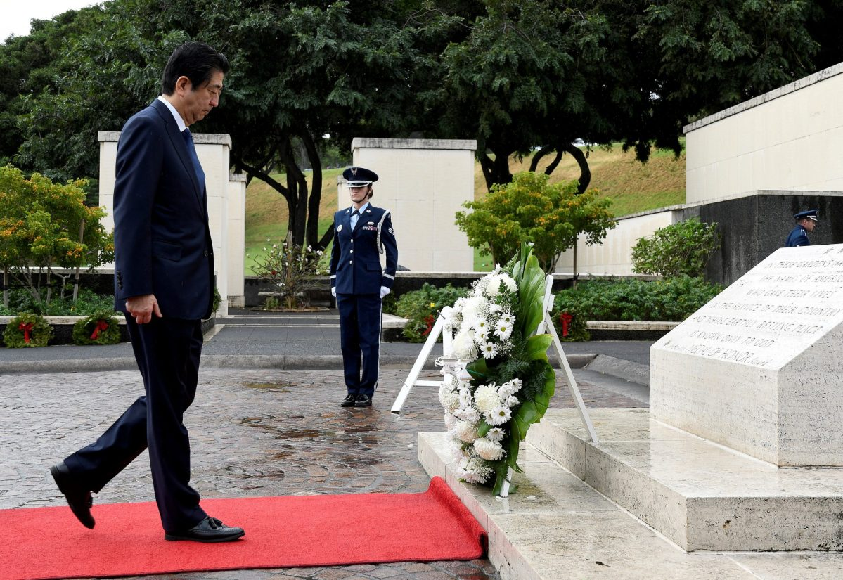 Japanese Prime Minister Shinzo Abe presents a wreath at the National Memorial Cemetery of the Pacific at Punchbowl in Honolulu, Hawaii, U.S. December 26, 2016. Reuters/Hugh Gentry