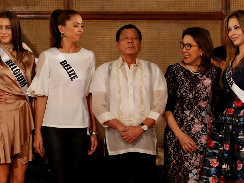 Self-confessed murderer, or national celebrity? So hard to tell these days as Rodrigo Duterte poses with Tourism Secretary Wanda Teo and Miss Universe candidates.  Photo: Reuters