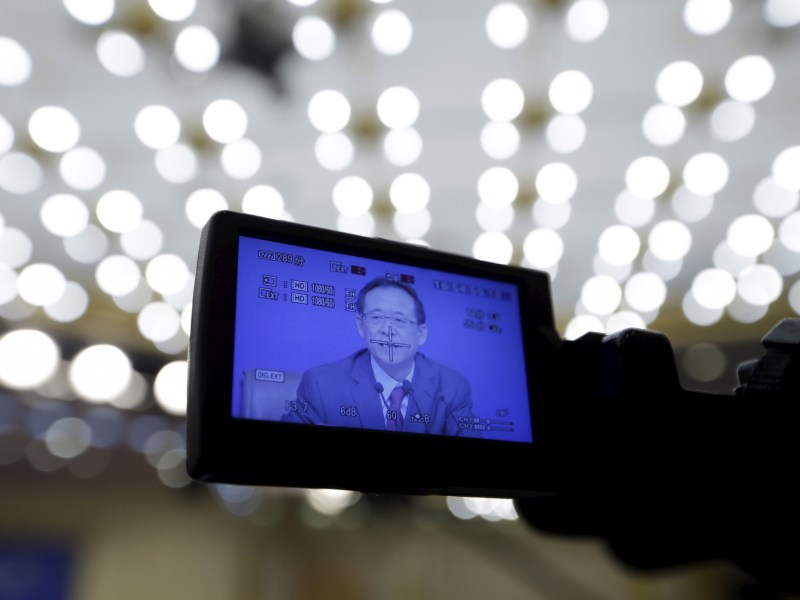 A screen shows Liu Shiyu, chairman of the China Securities Regulatory Commission, speaking at a news conference on the sidelines of the National People's Congress (NPC), in March. Photo: REUTERS/Jason Lee