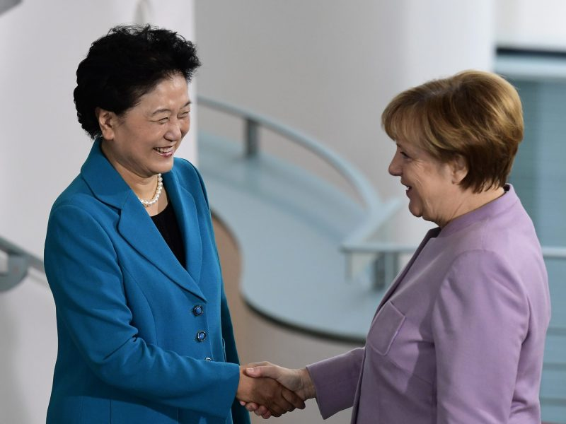 German Chancellor Angela Merkel shakes hands with Chinese Vice Premier Liu Yandong  after signing cooperation agreements that lay the groundwork for closer ties between the countries and their soccer clubs. Photo: Agence France-Presse, Tobias Schwarz