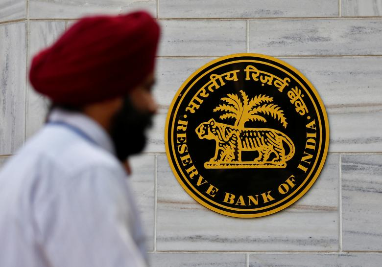 A man walks past the Reserve Bank of India head office in Mumbai. Photo: Reuters/Danish Siddiqui