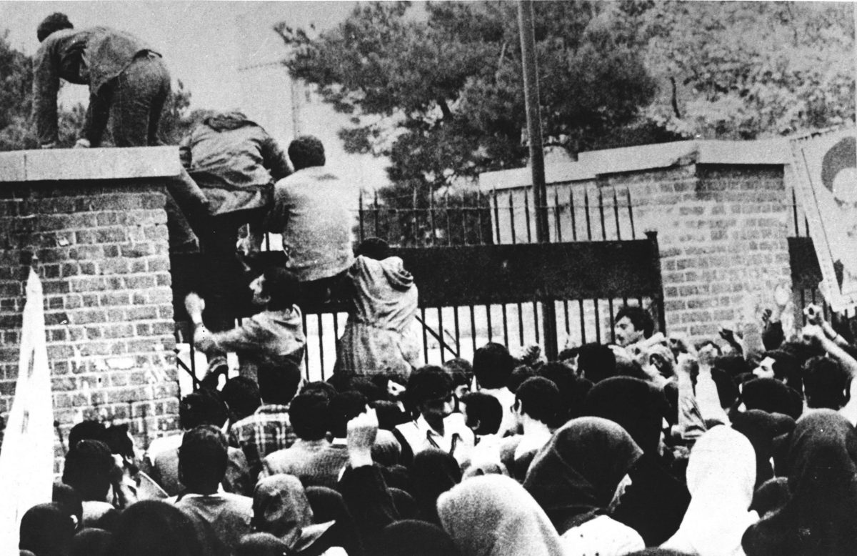 Iranian students climb over the wall of the US embassy in Tehran, November 4, 1979. Photo: AFP / IRNA