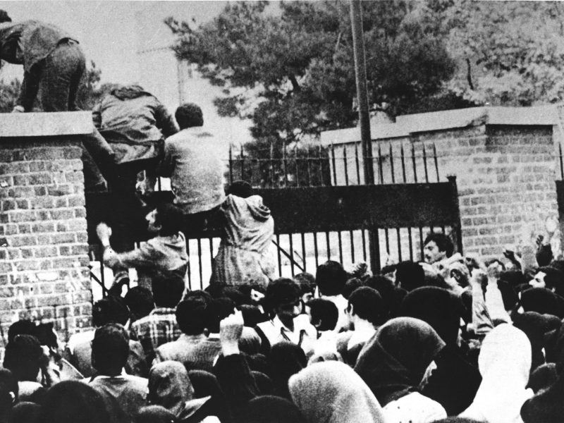 Iranian students climb over the wall of the US embassy in Tehran, November 4, 1979. Photo: AFP / IRNA