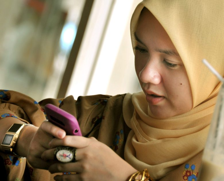 An Indonesian woman plugs into social networking platforms on her mobile phone in Jakarta. Photo: AFP/Bay Ismoyo