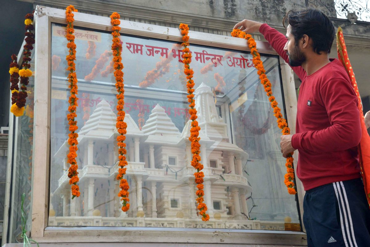 A man garlands a model of a Ram temple during a procession marking the 24th anniversary of the demolition of the Babri Masjid Mosque in Ayodhya, in Amritsar on December 6, 2016.  Photo: AFP / NARINDER NANU