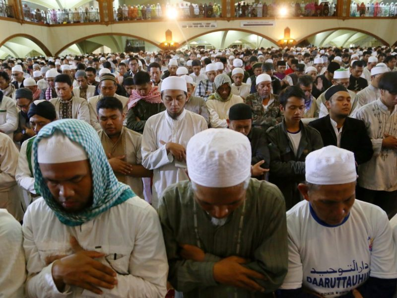 Indonesian Muslims hold dawn prayers on December 12, 2016, one day before Jakarta's Christian governor Basuki Tjahaja Purnama's first trial as some Islamic groups have vowed to maintain pressure until he is prosecuted for blasphemy. The high-profile case has emboldened hardline groups and stoked fears of growing intolerance in the world's largest Muslim-majority nation. Photo: AFP / Kahfi Syaban Nasuti