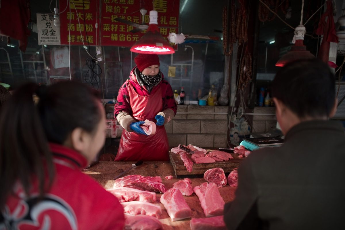 It's a bad time to be a pig in China right now, as the world's most populous nation digs deep in preparation for the new year holiday feasting, putting a squeeze on cash supply. Photo: AFP
