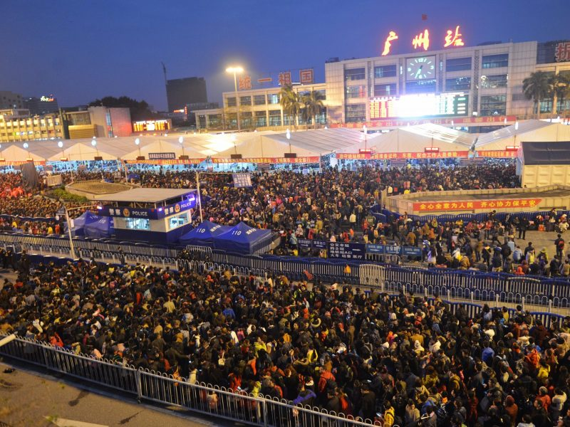 Crowds of Chinese passengers who go back home for the upcoming Chinese Lunar New Year, also known as Spring Festival, wait on the square in front of the Guangzhou Railway Station after trains were delayed due to snow and ice in Guangzhou city, south China's Guangdong province, 2 February 2016. Photo: AFP