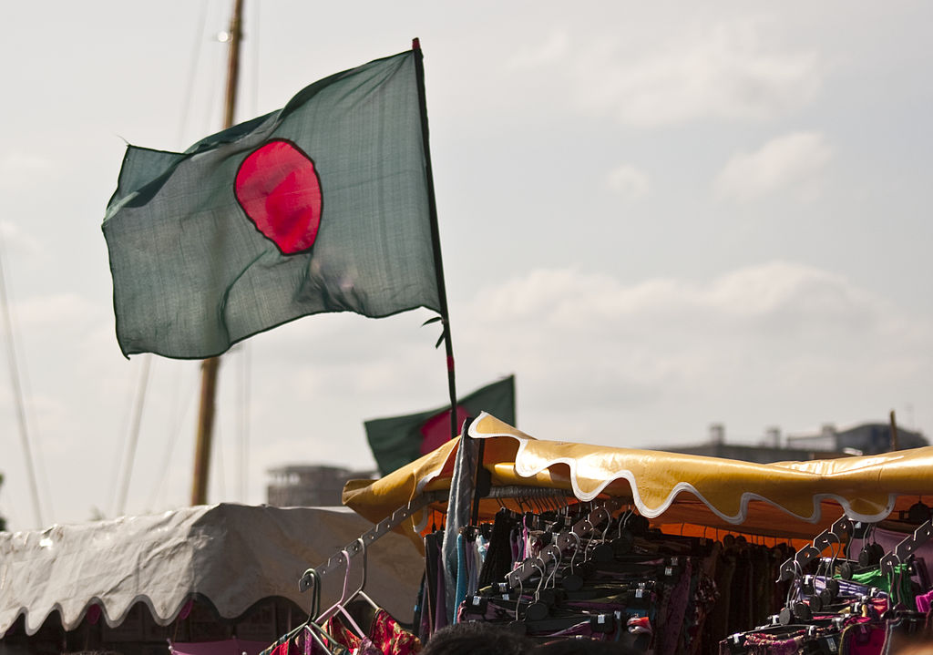 The flag of Bangladesh. The red disc symbolizes the sun rising over Bengal, while the red represents the blood of victims in the country's struggle for independence. Photo: Wikimedia Commons